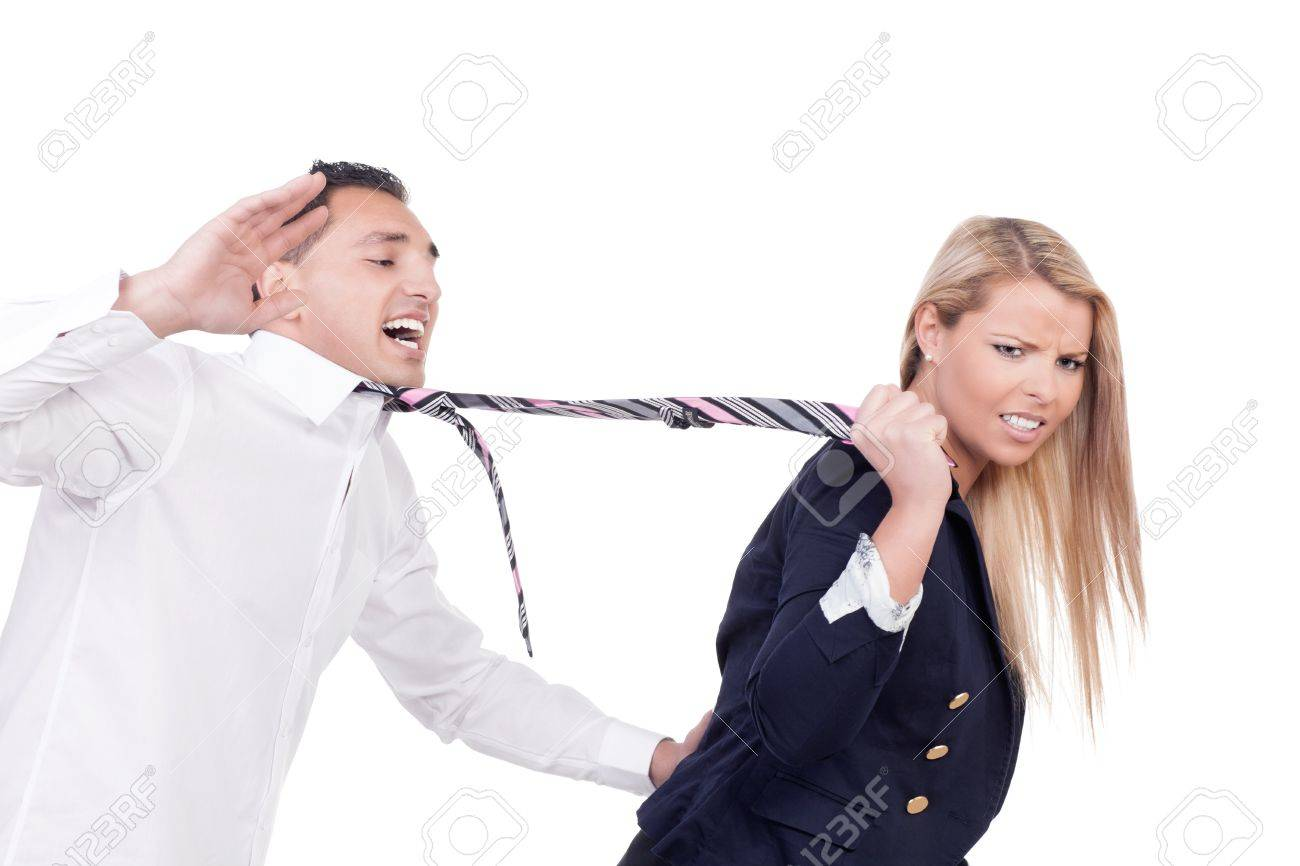 Attractive blonde woman with a disgruntled frowning expression pulling a protesting man along behind her by his tie isolated on white Stock Photo - 19293347