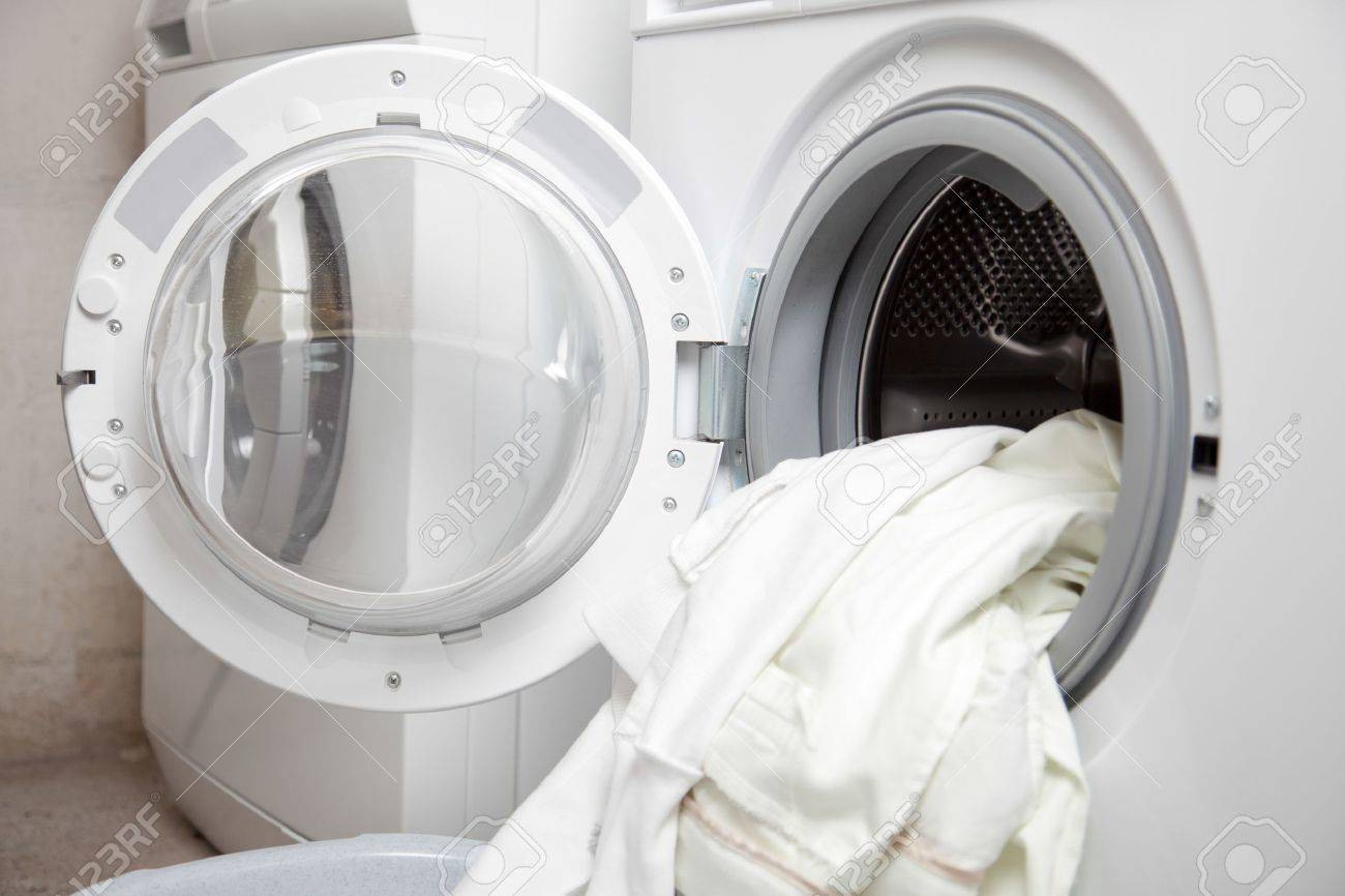 Some dirty clothes in the washing machine Stock Photo - 20915027