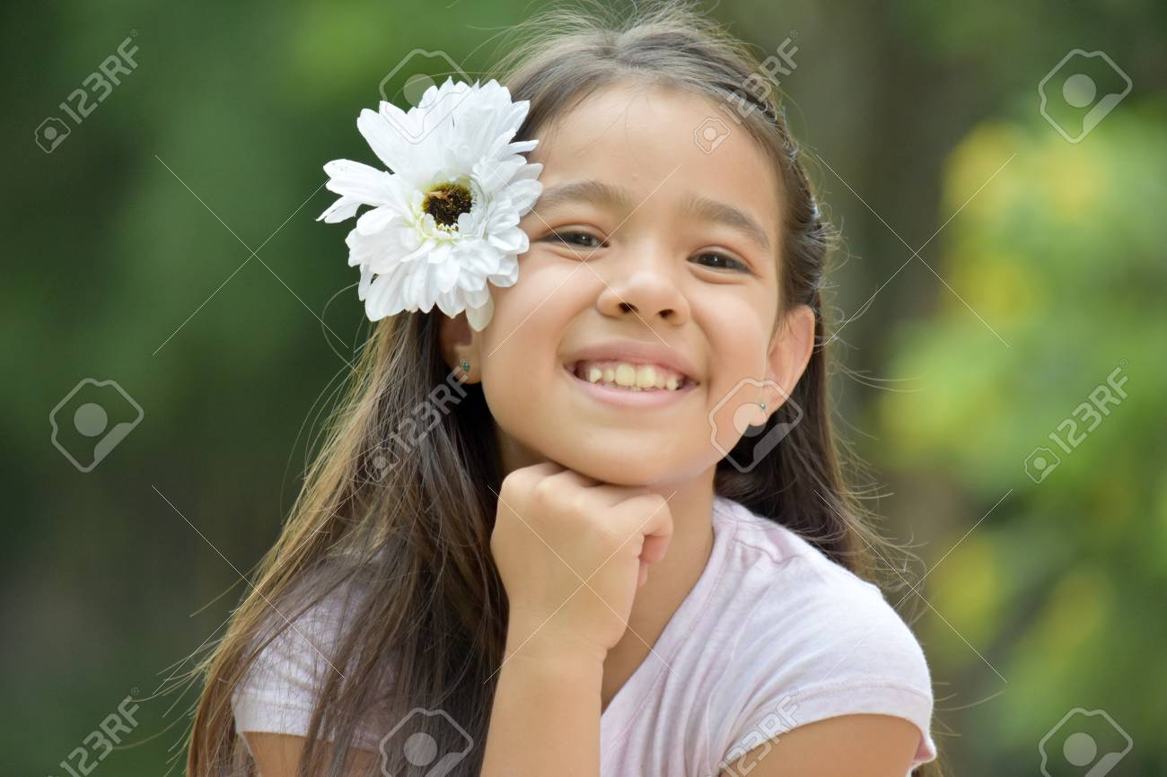 Cute Girl Smiling With A Daisy