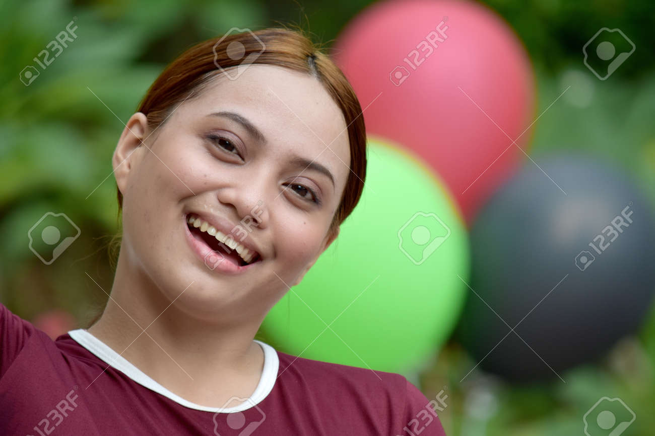 Happy Youthful Redhead Female Wearing Tshirt With Balloons - 159398980