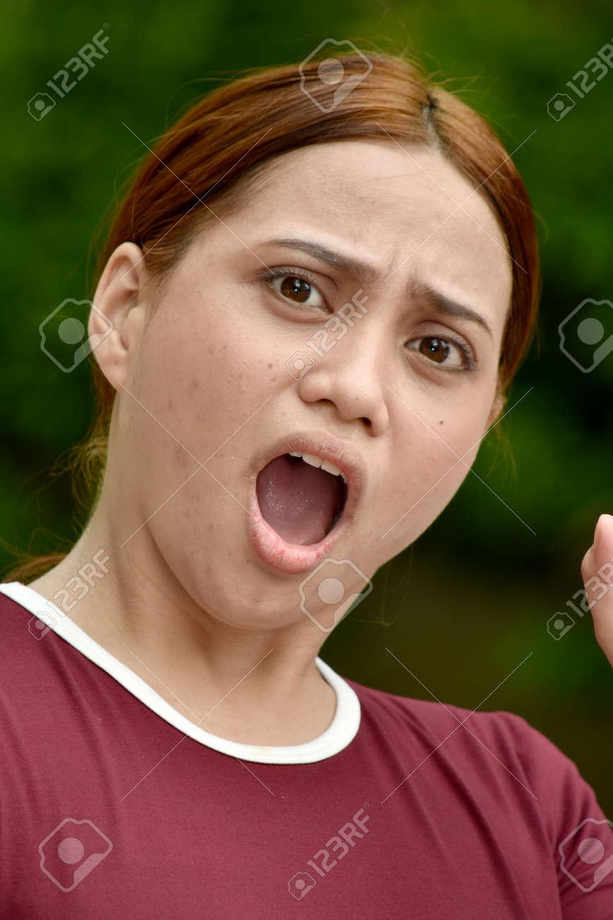 A Fearful Youthful Filipina Female - 159548883