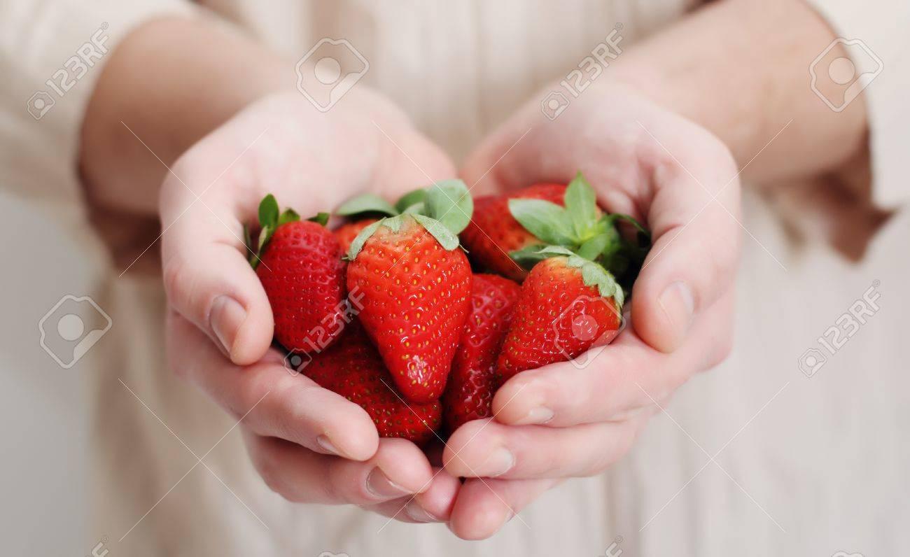 man holding a strawberry Stock Photo - 12693286