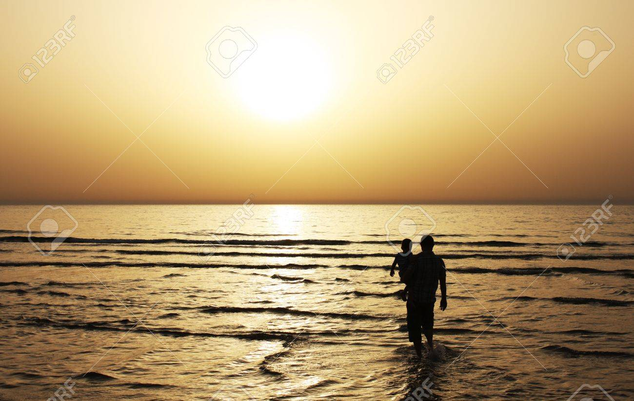 Father and son watched together at sunset Stock Photo - 12785305