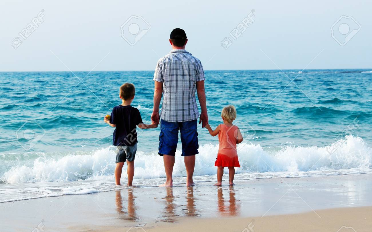 father with two kids on vacation at sea Stock Photo - 16139229