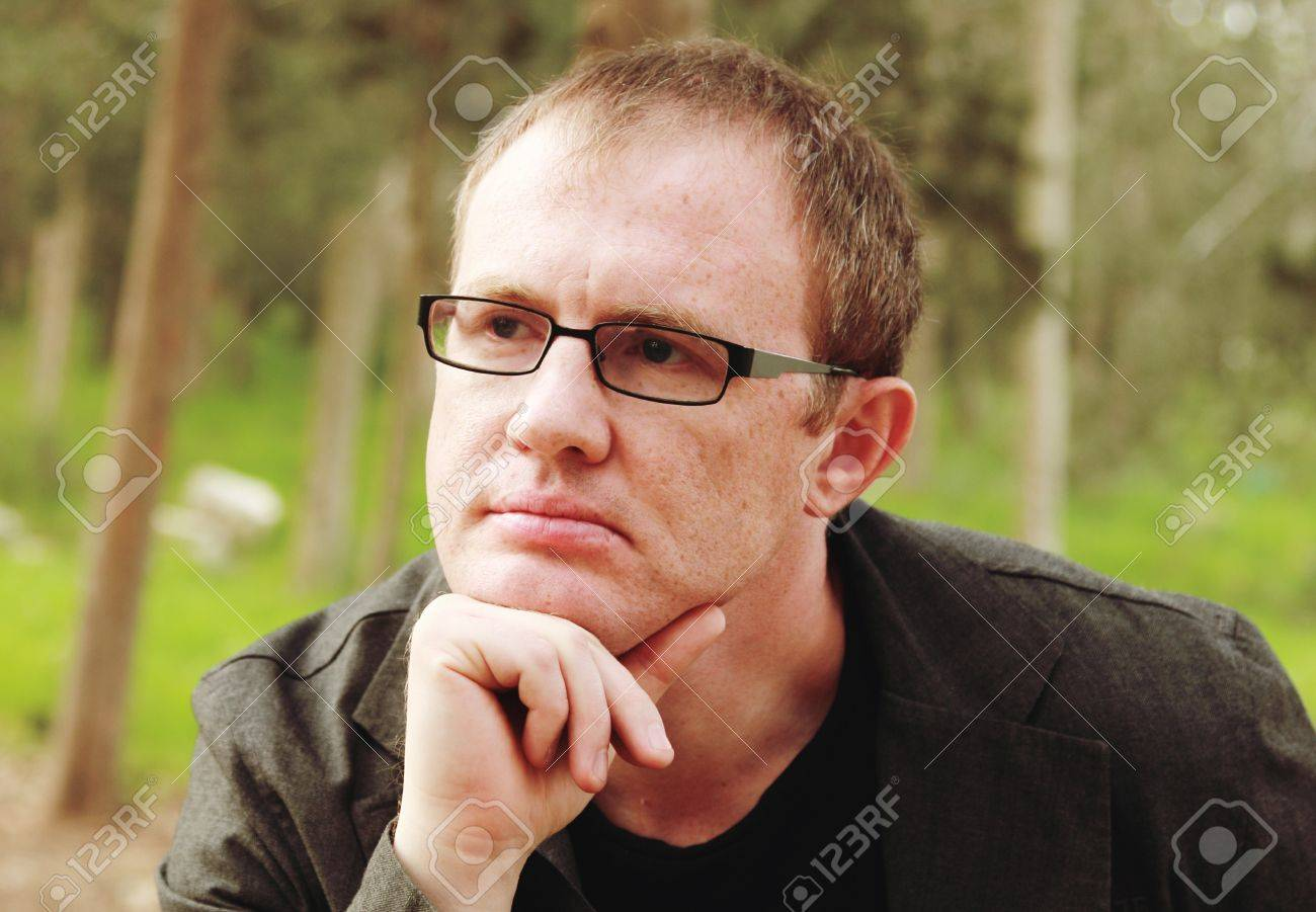 3ed7552266fa handsome 35 years old man with glasses outdoors Stock Photo - 18808701