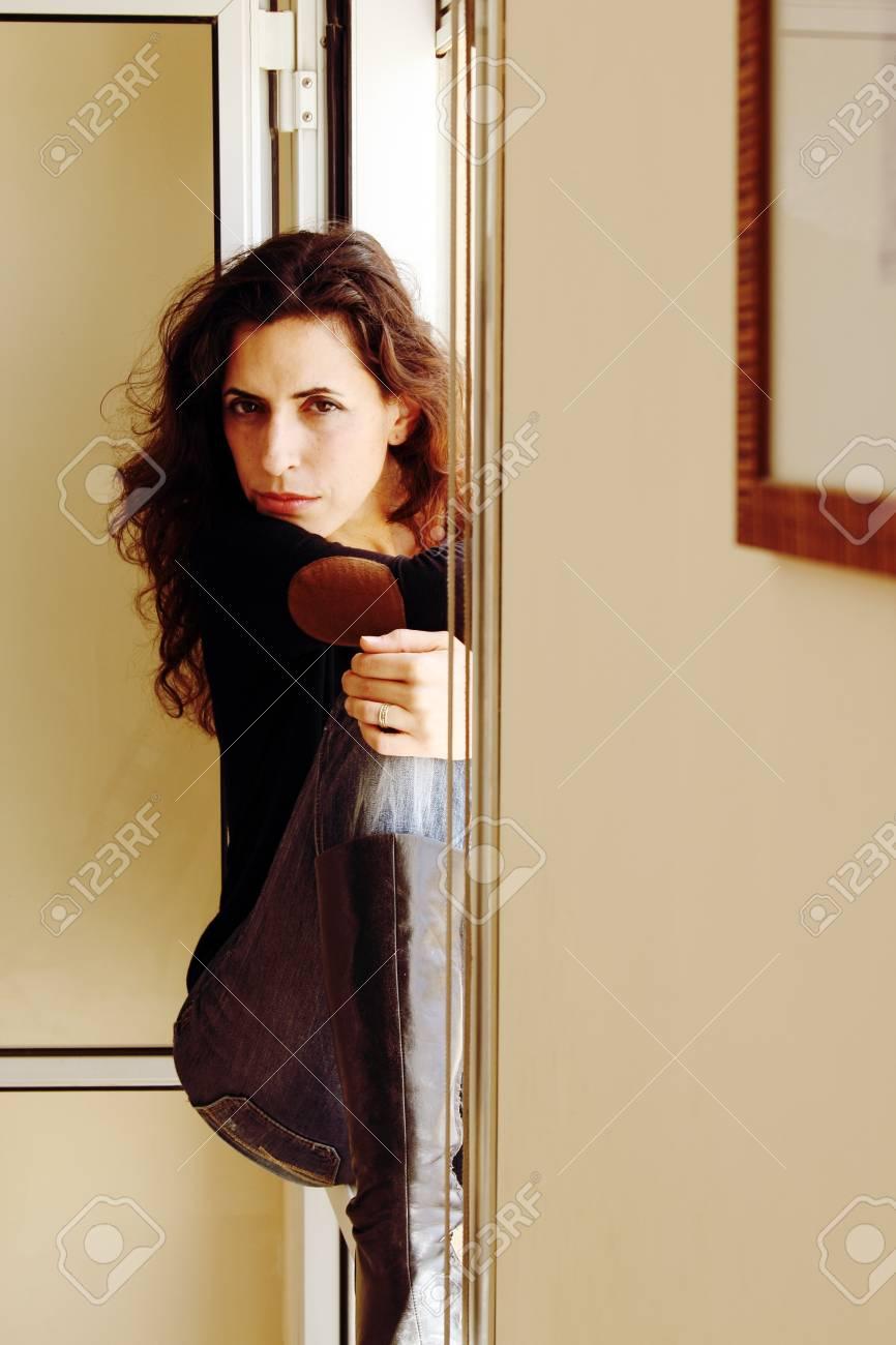 Portrait of beautiful woman sitting on the window Stock Photo - 19347963