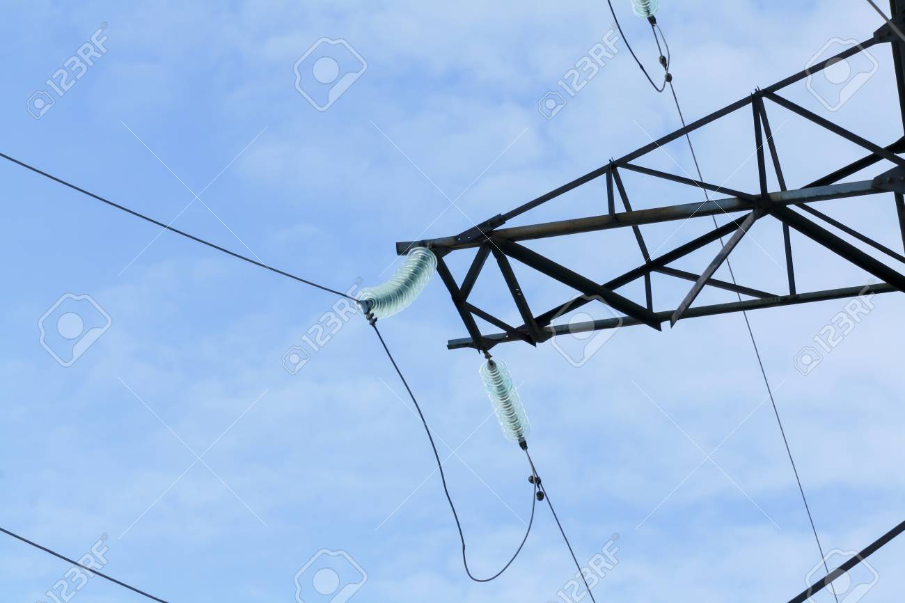 Electric High-voltage Wires Hanging On The Electric Poles Stock ...