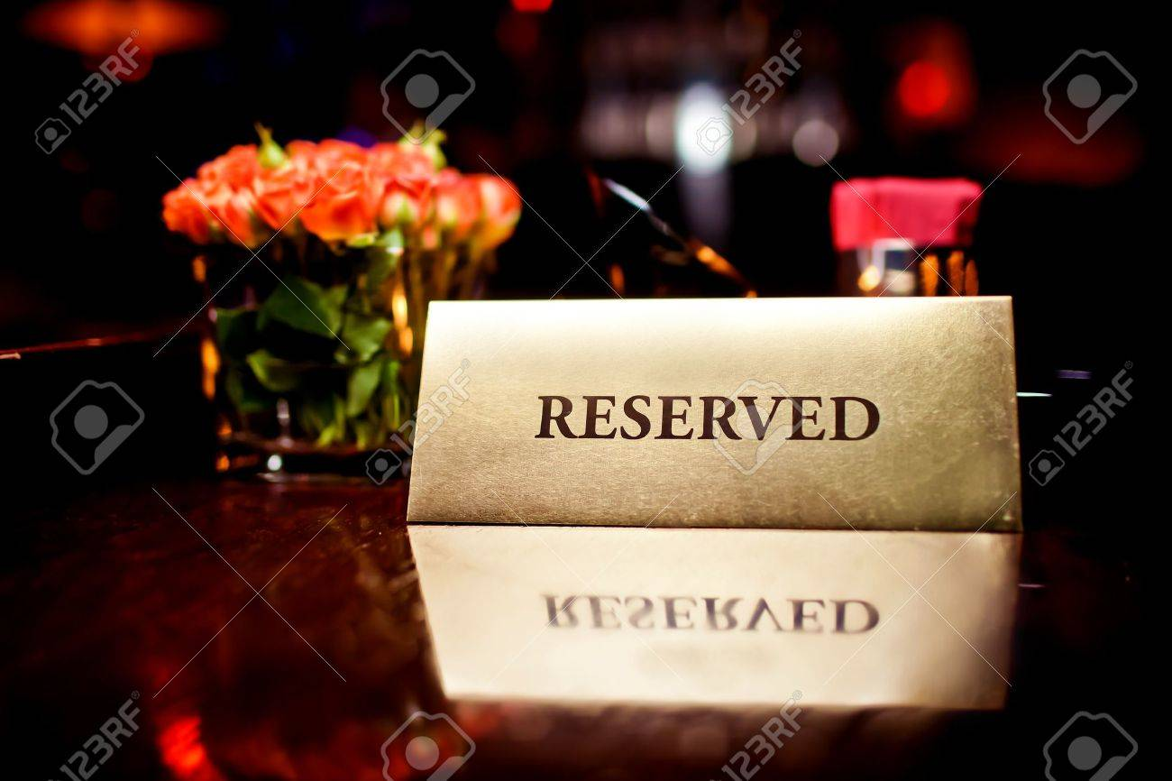 Reserved sign in restaurant Stock Photo - 12124467