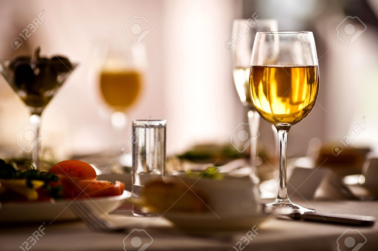 Fancy restaurant table setting - Glasses Set With Drinks In Restaurant Stock Photo 14099053
