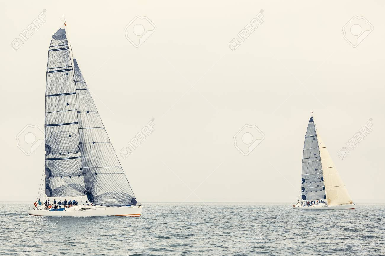 Sailing ship yachts with white sails in the open sea Stock Photo - 22059483