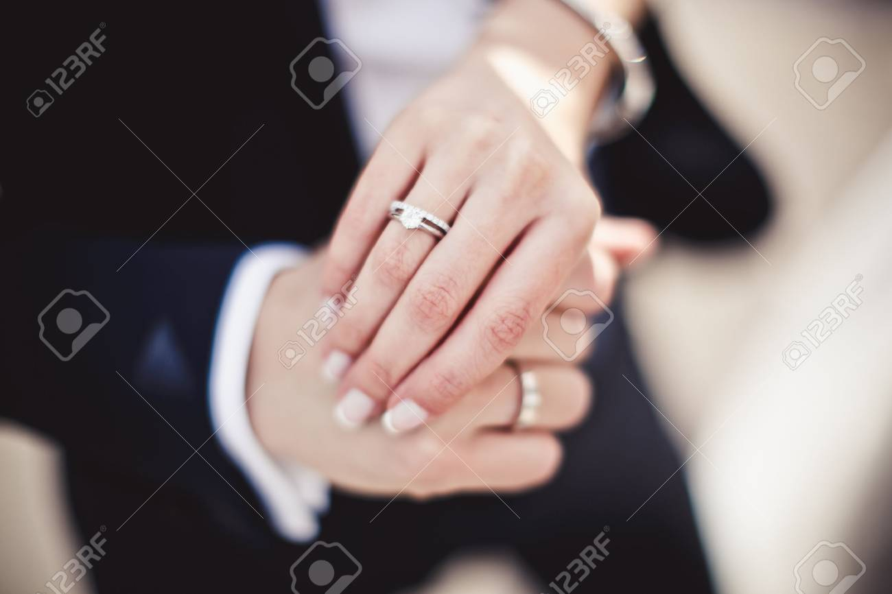 Close Up Of Holding Hands With Wedding Rings Stock Photo, Picture ...