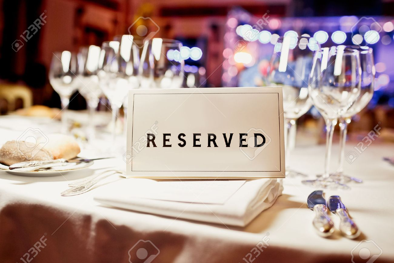 Fancy restaurant table setting - Fine Dining Reserved Sign On A Table In Restaurant Stock Photo