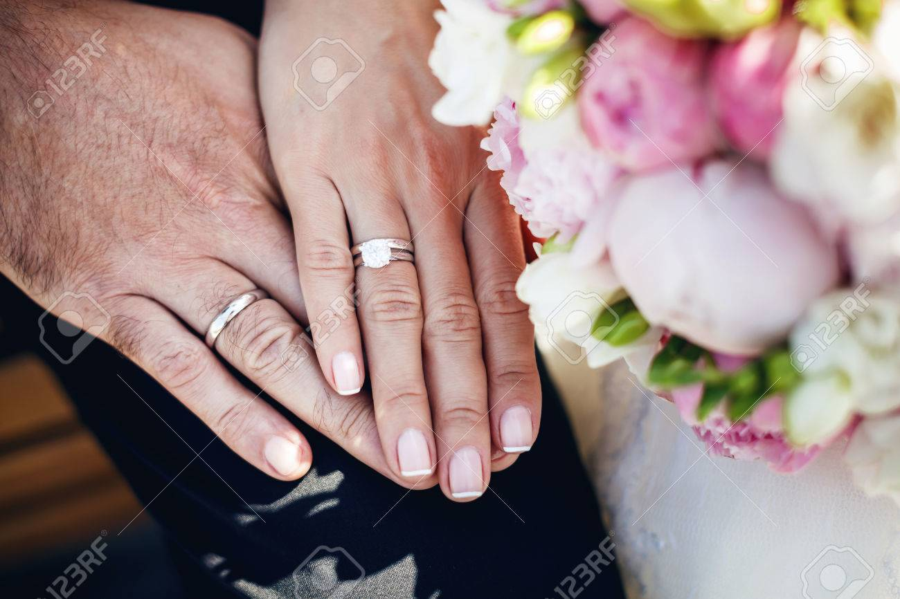 Hands With Wedding Rings Stock Photo, Picture And Royalty Free Image ...