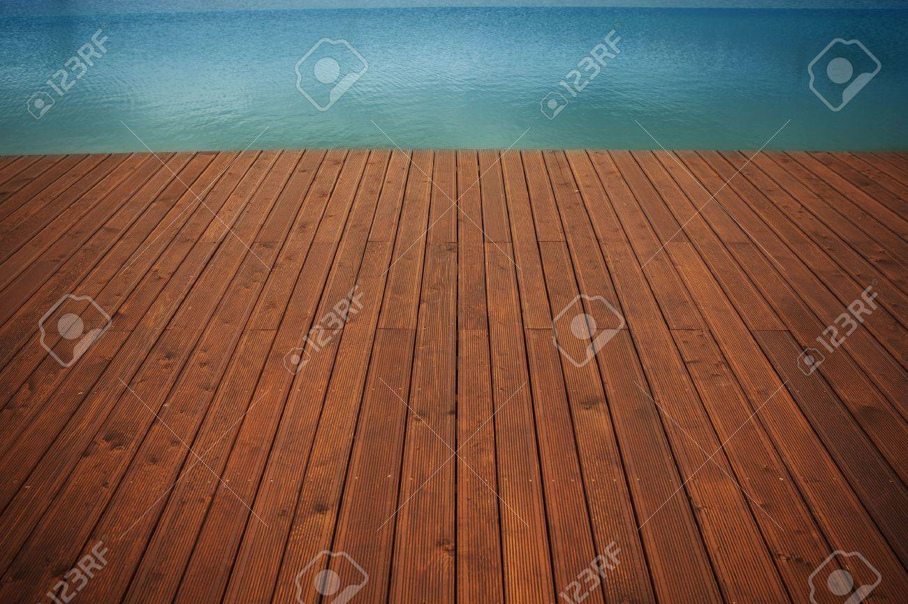 Wooden wharf and blue water Stock Photo - 9972123