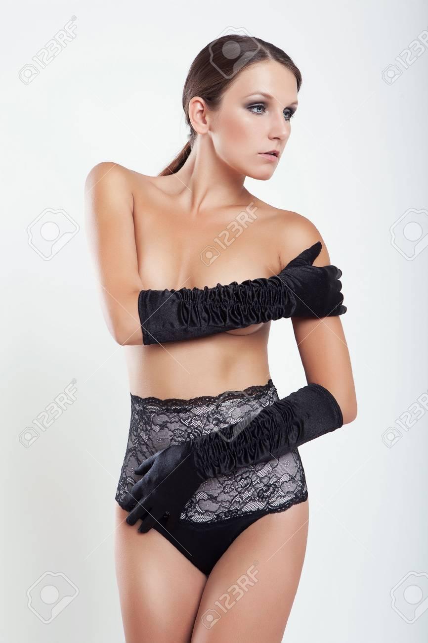 Tan brunette fake boobs