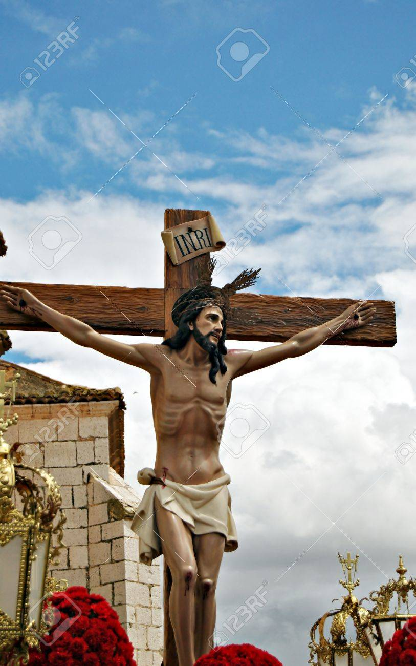 jesus christ on the cross during a procession of holy week in