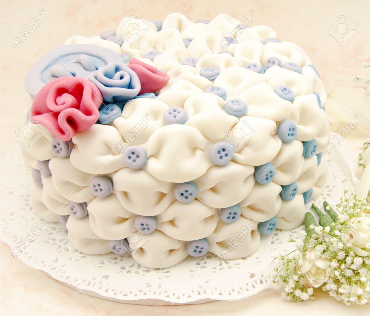 White Wedding Cake With Blue Flowers On White Background Stock Photo ...