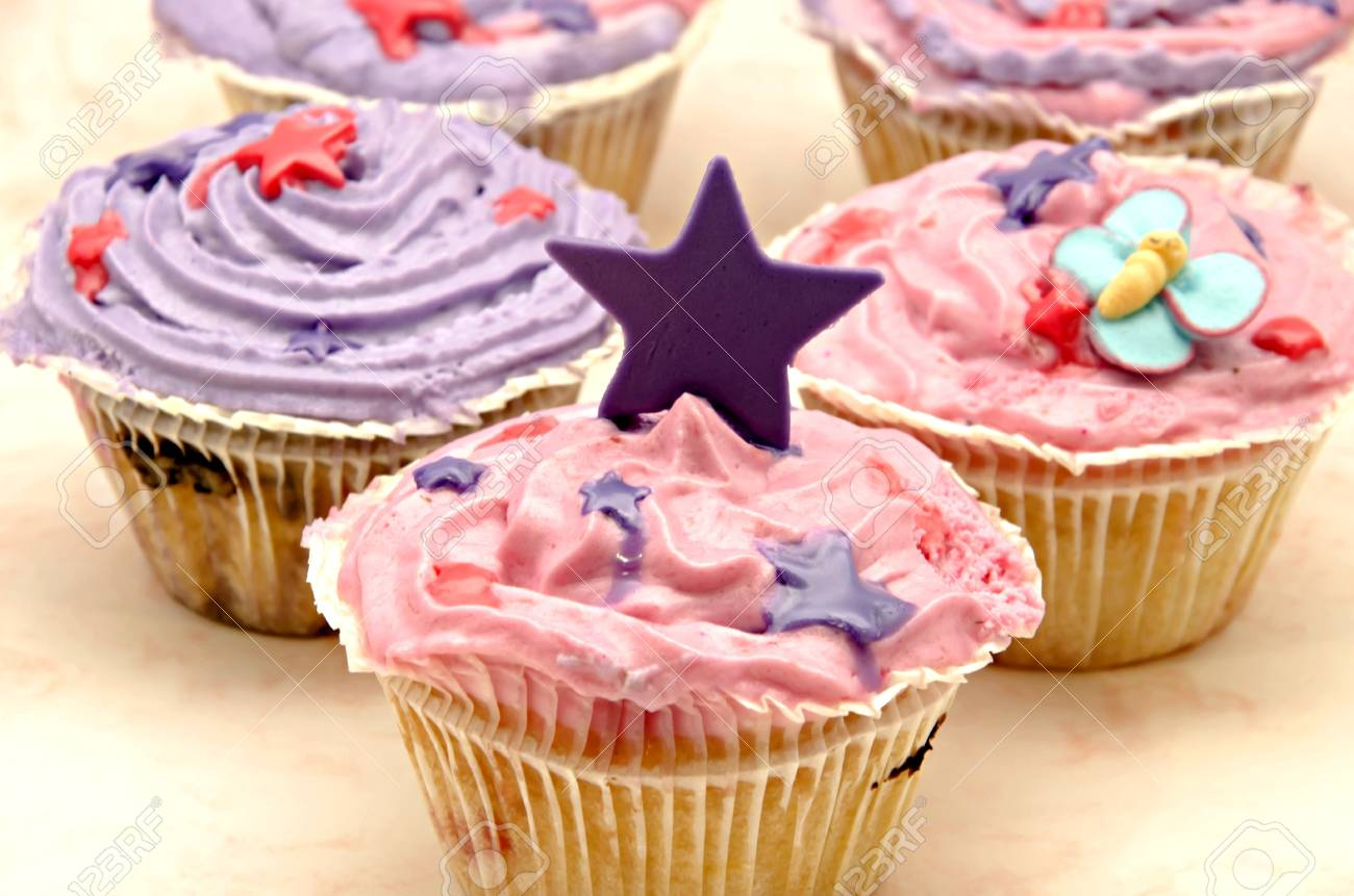 Delicious cupcakes decorated with cream and candy colored ornaments Stock Photo - 15687794