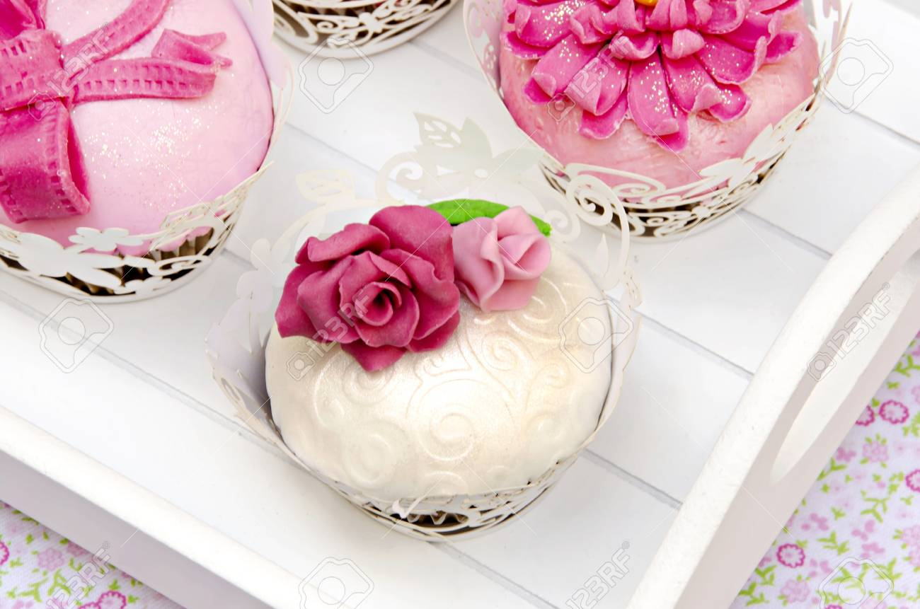 Cupcakes decorated with fondant and sugar flowers Stock Photo - 16513408