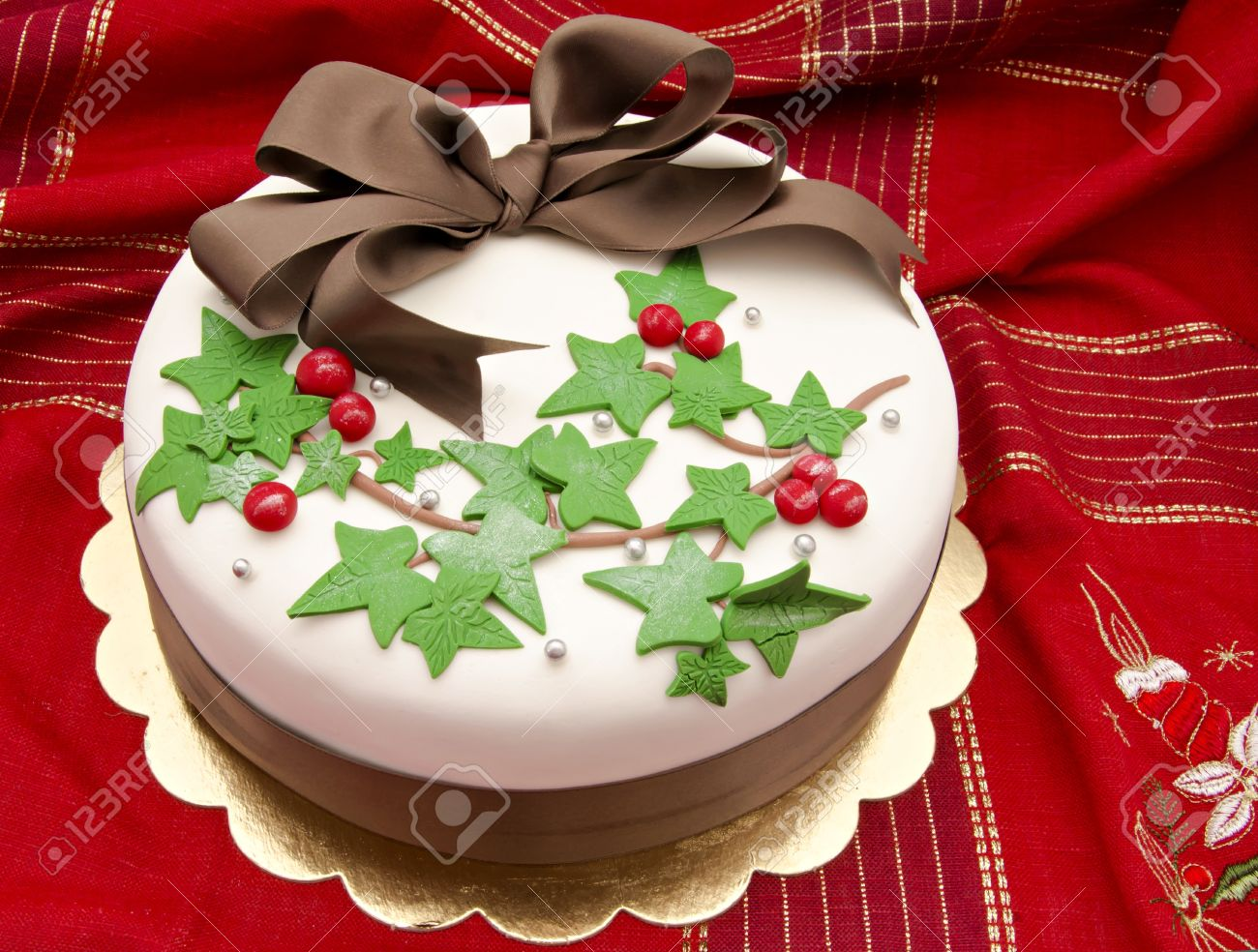 Christmas Cake Decorated With Fondant Holly Leaves Stock Photo