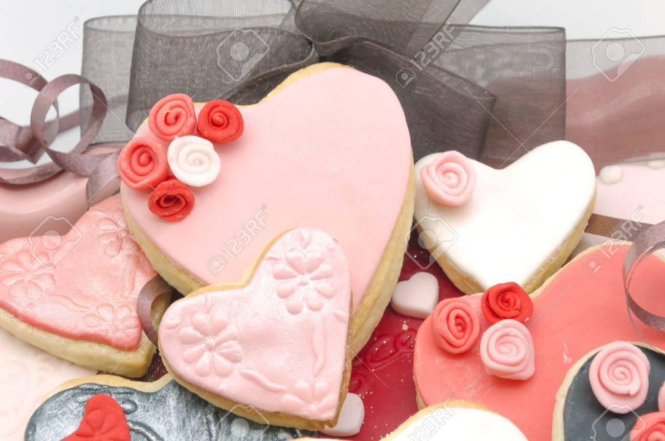 valentine cookies decorated with fondant stock photo 25160567 - Decorated Valentine Cookies