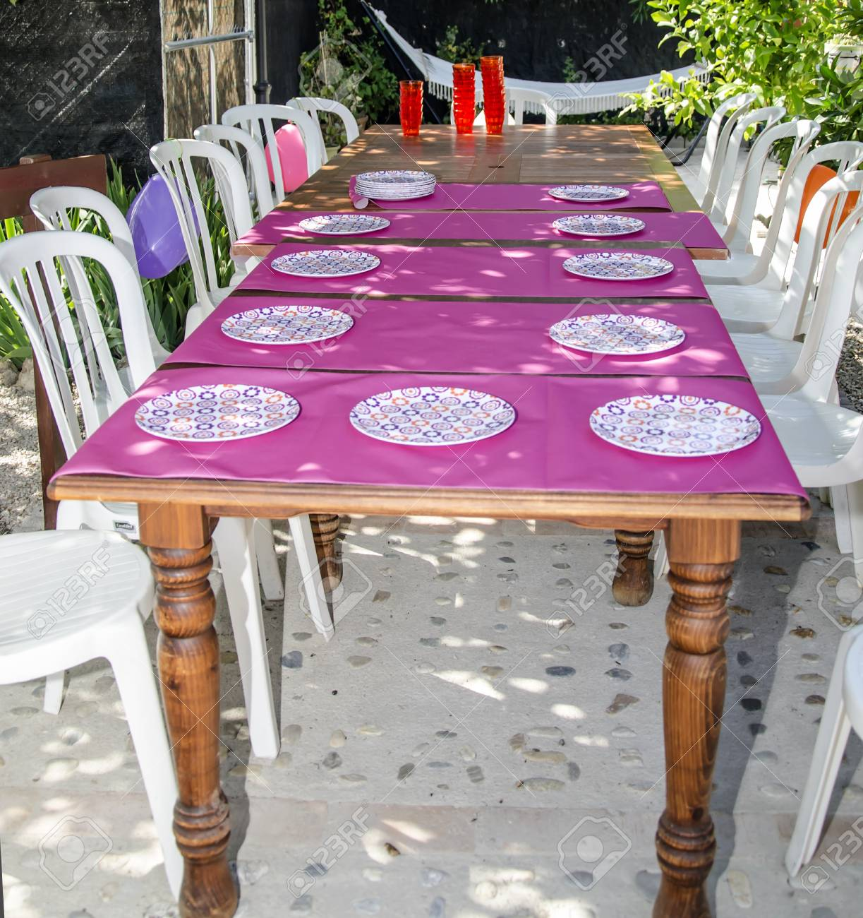 Stock Photo   Table Decorated With Colorful Tablecloths And Crockery
