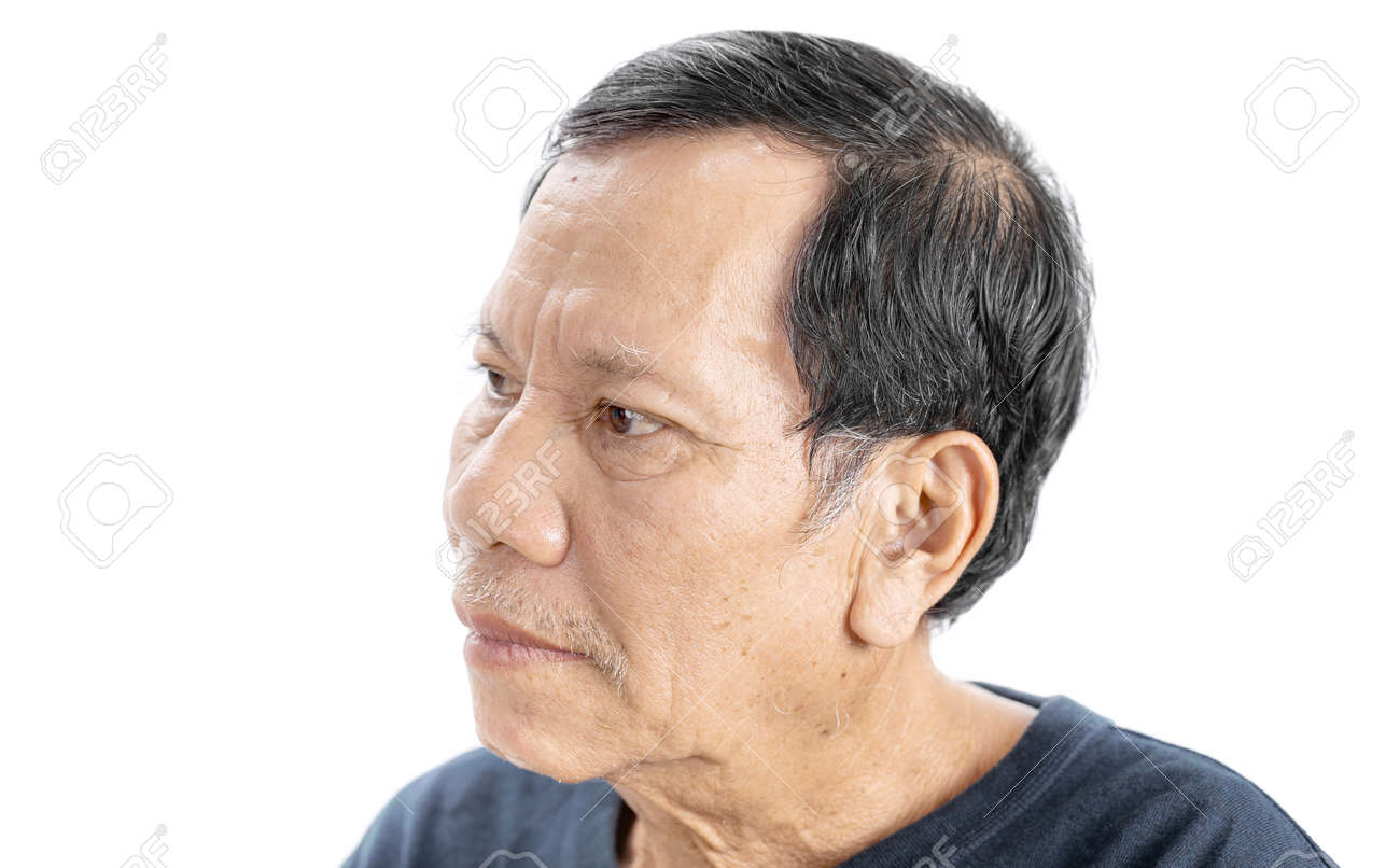old wrinkled asian man portrait with serious mood and wear navy blue t-shirt isolated on white background - 125397344