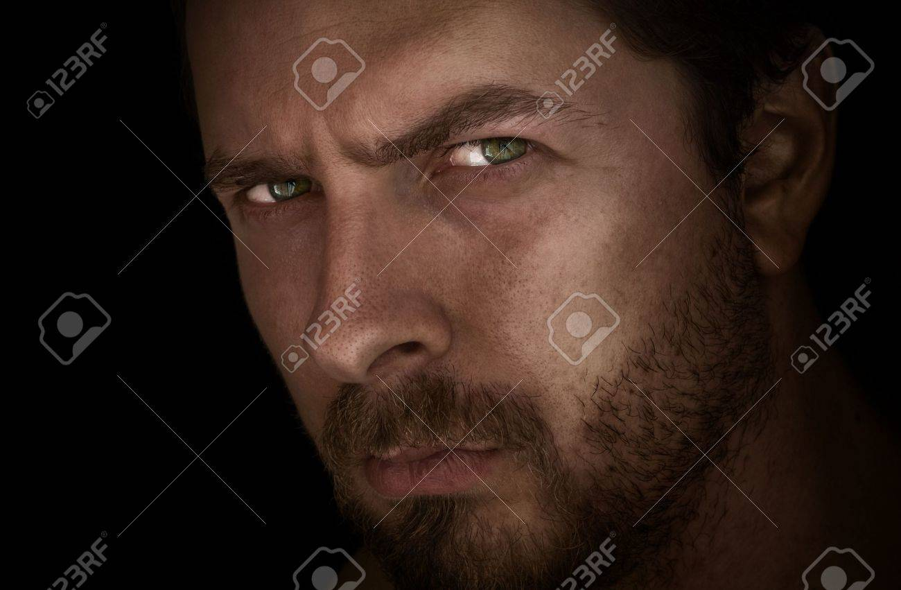 Low-key portrait of man with mysterious eyes Stock Photo - 3558933