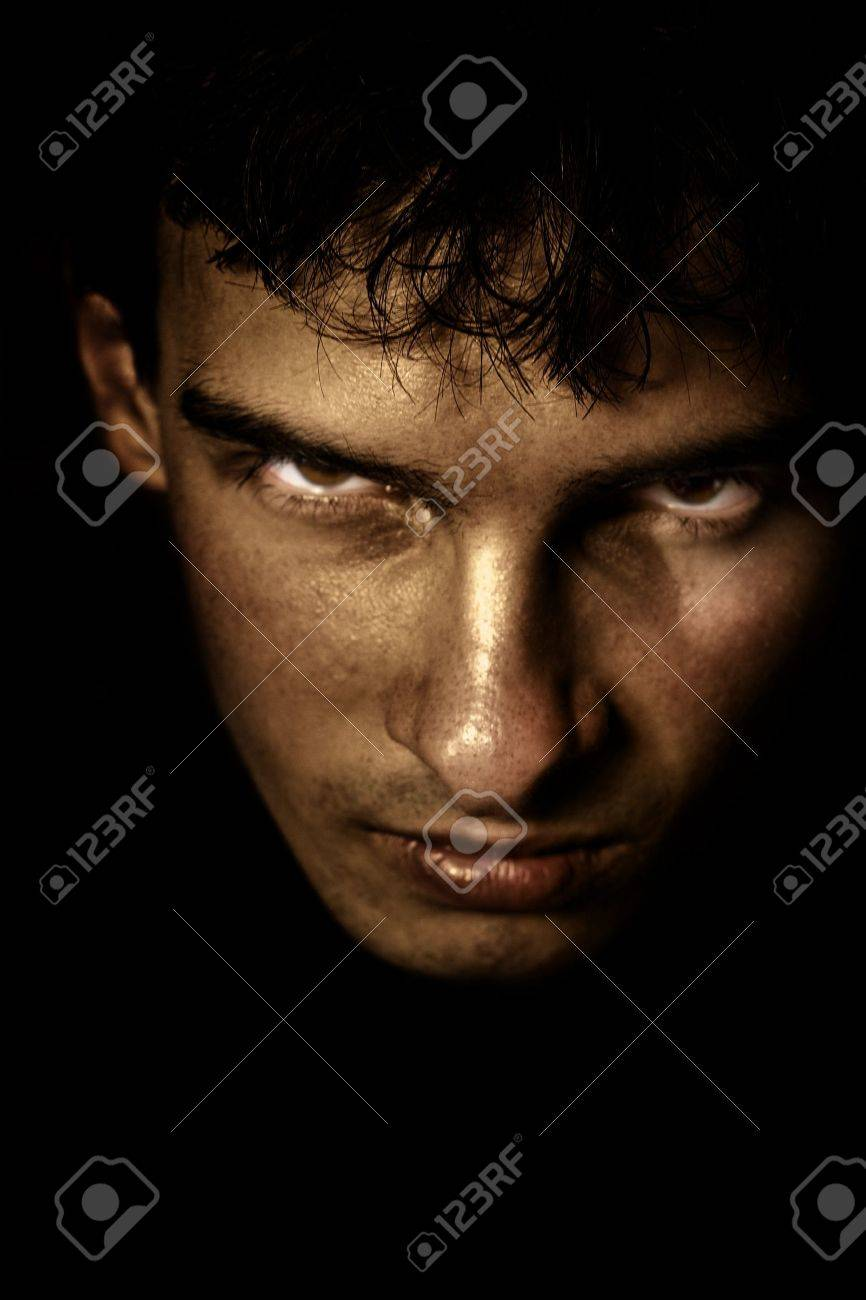 Low key portrait of evil looking man Stock Photo - 3724858