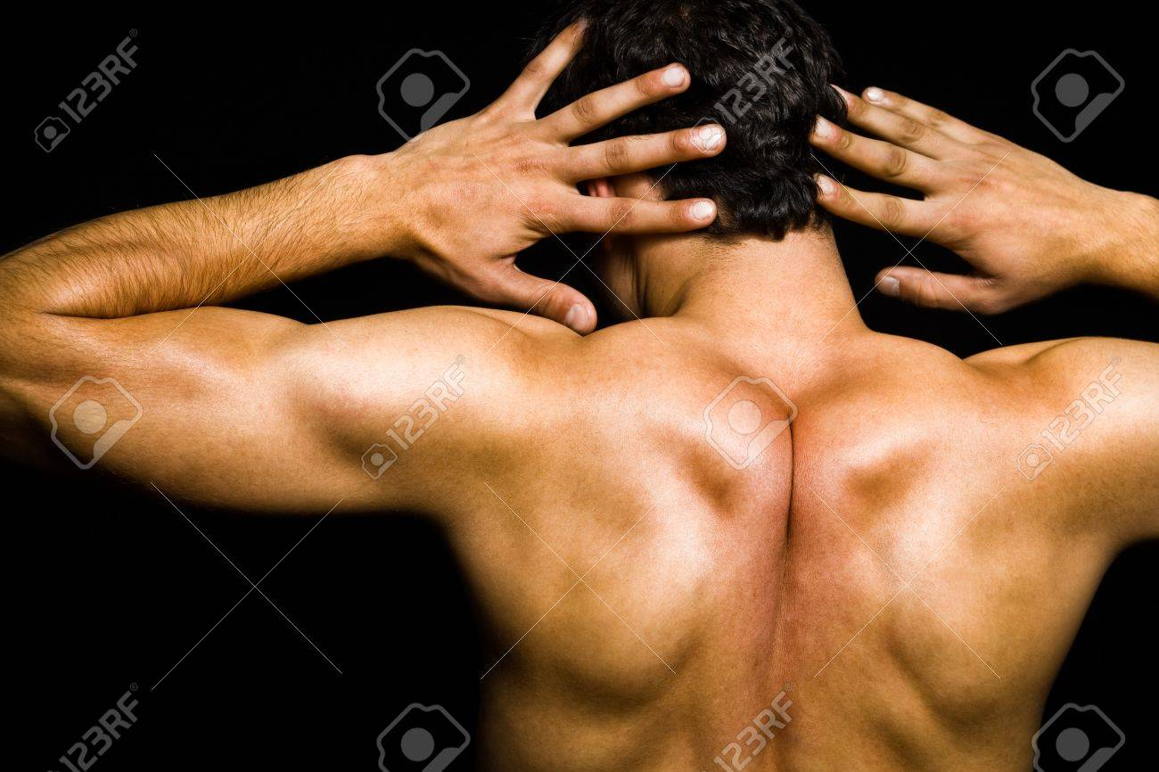 Artistic pose - back of muscular man over black Stock Photo - 4301254