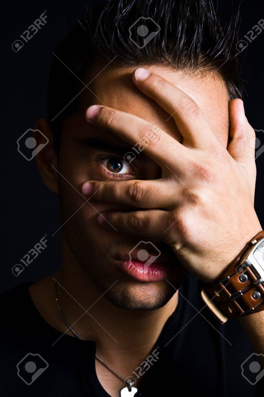 Portrait of shy man hiding with hand on face Stock Photo - 4331742