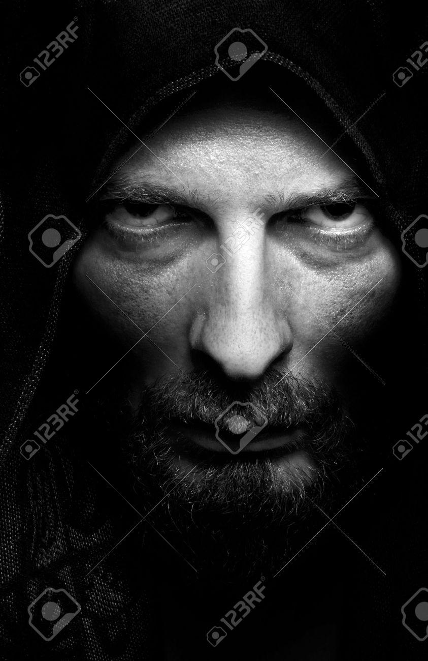 Dark portrait of scary evil sinister bearded man Stock Photo - 5579503