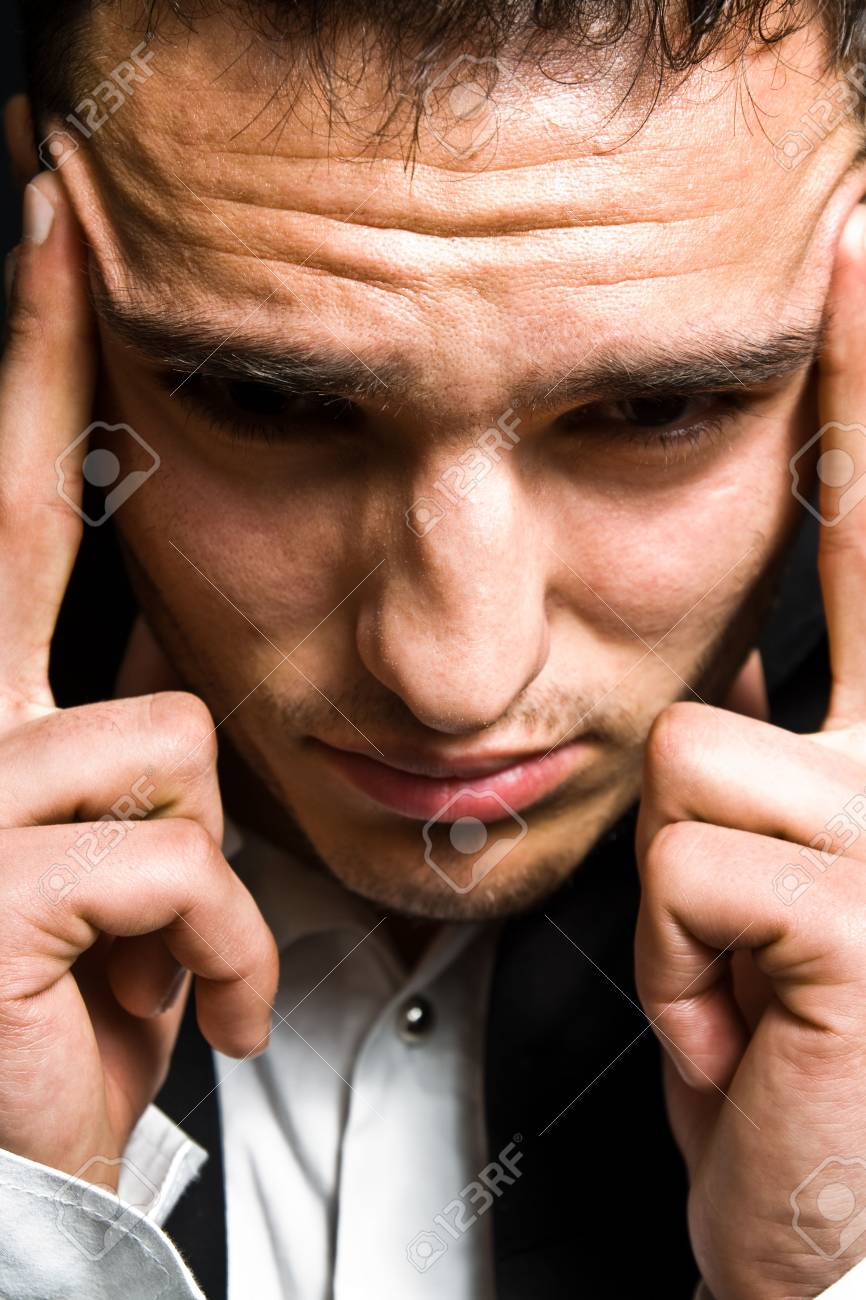 Stress concept - business man with big headache Stock Photo - 6181445