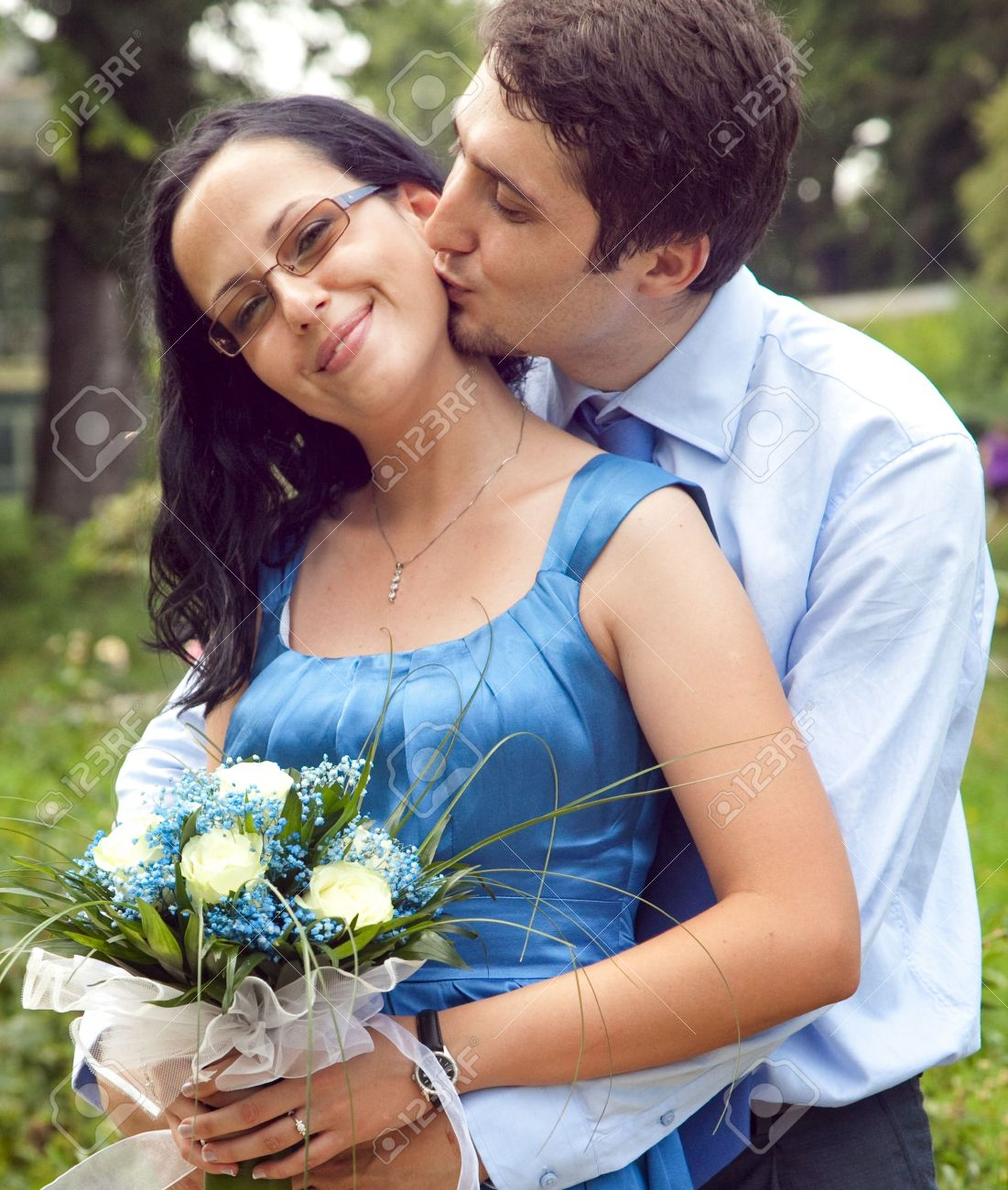 cute couple in a kiss and hug romantic moment stock photo, picture