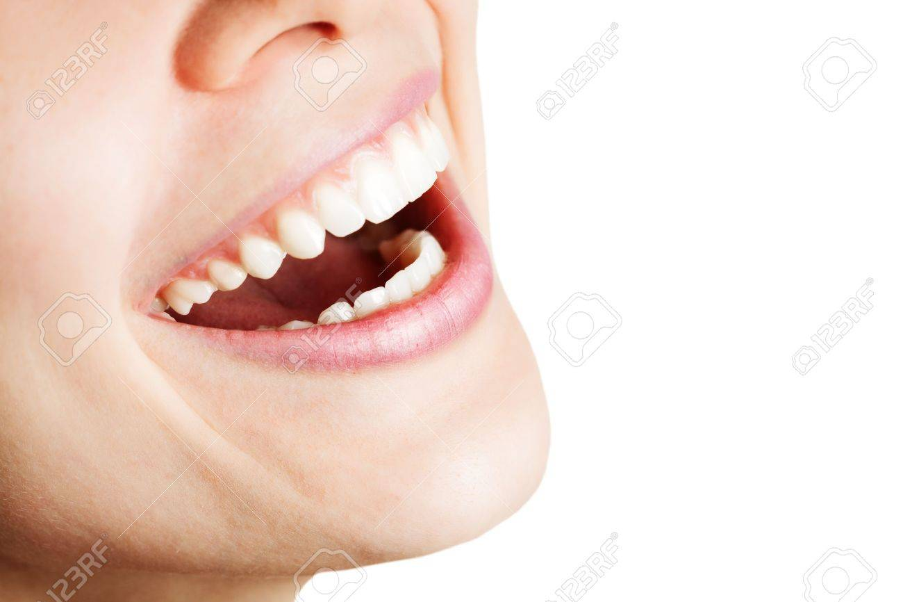 Laugh of happy woman with healthy white teeth Stock Photo - 7018486