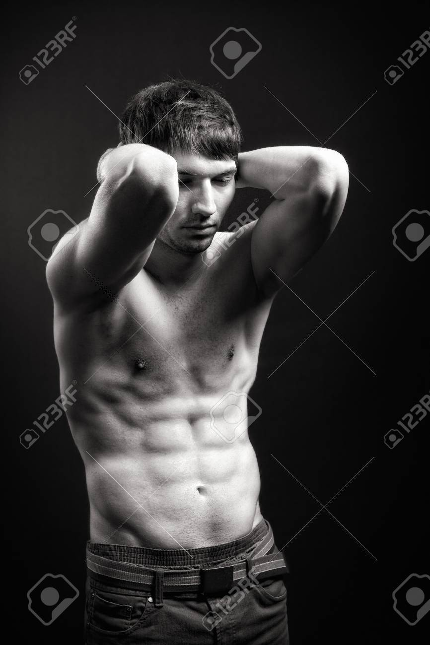 Fit man with sexy abdomen muscles over black Stock Photo - 7018431