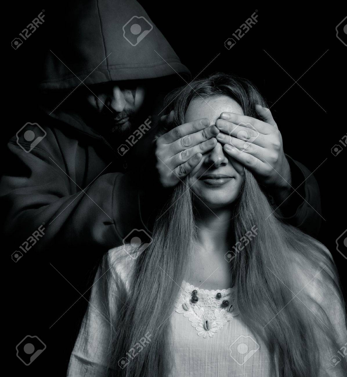 Halloween surprise - evil man behind innocent naive girl Stock Photo - 7820097
