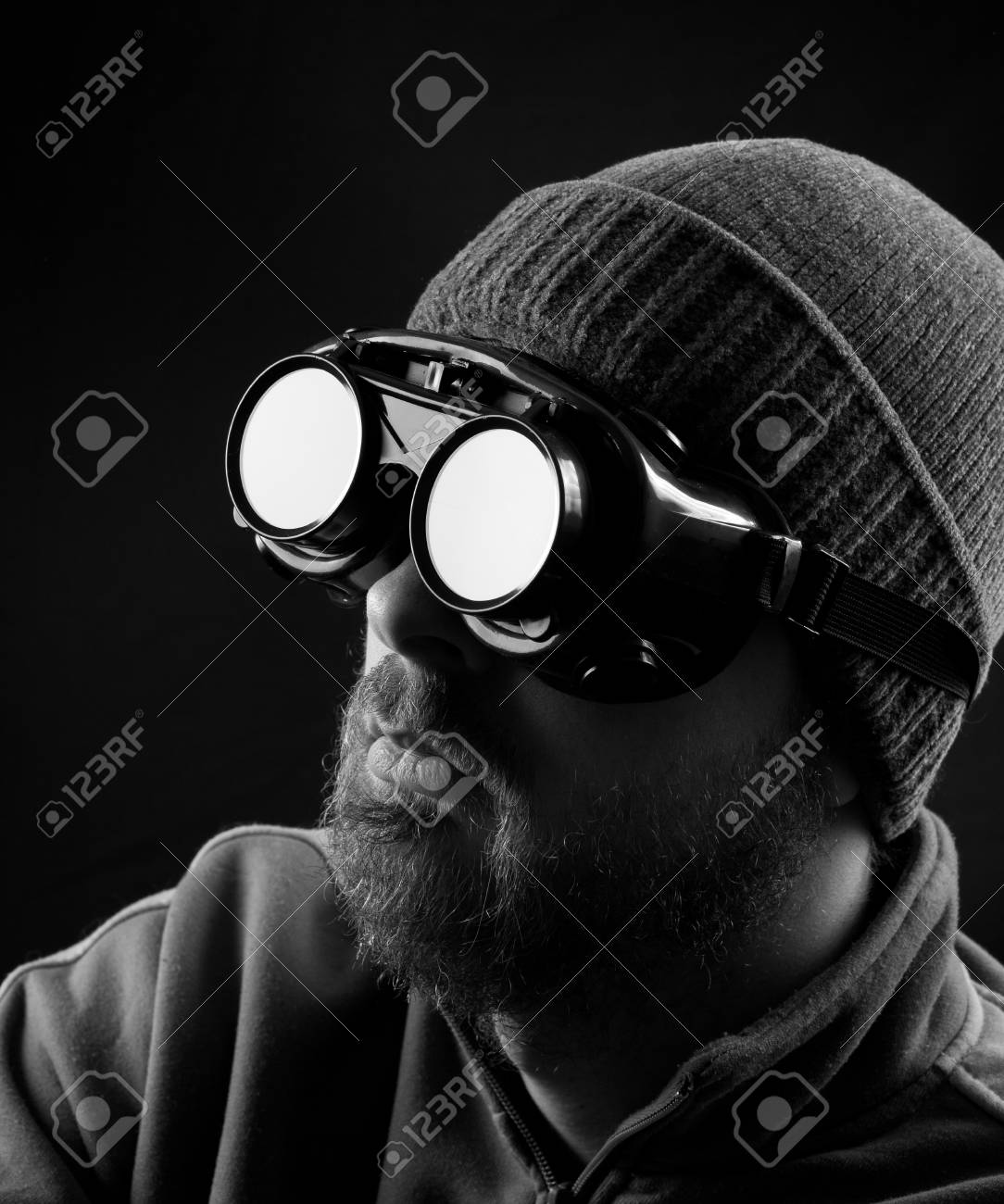 Man wearing protective goggles over black background Stock Photo - 8880892