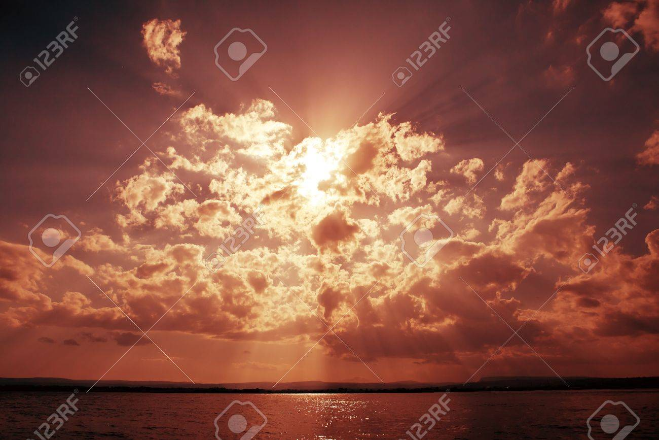 Dramatic sky with clouds and sun beams over ocean Stock Photo - 9834635