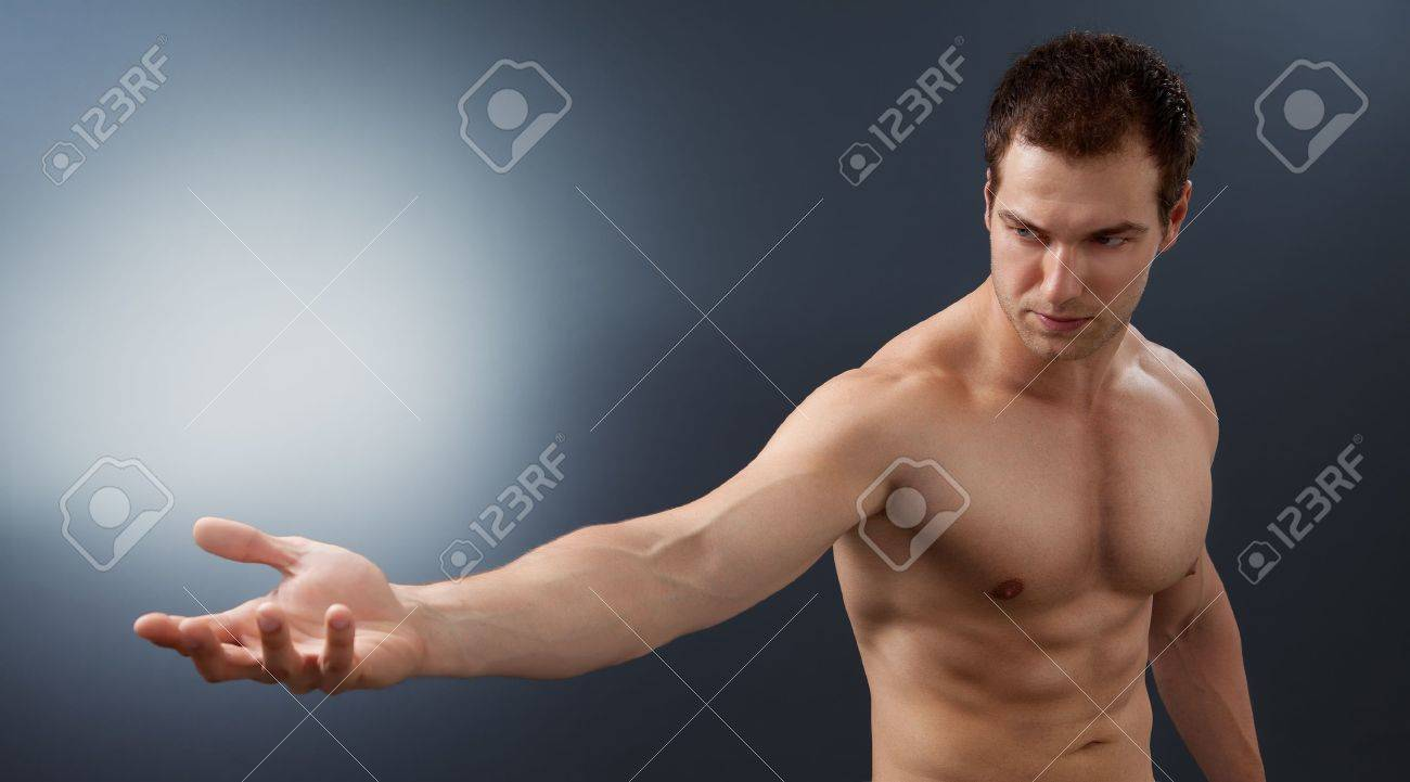 Light and power concept - creative muscular man holding bright sphere Stock Photo - 10059767