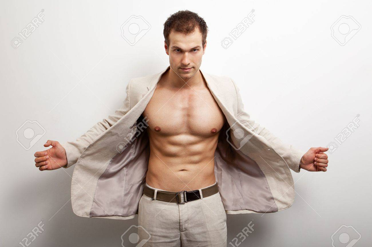 Sexy handsome man with fit muscular body over white Stock Photo - 10059773