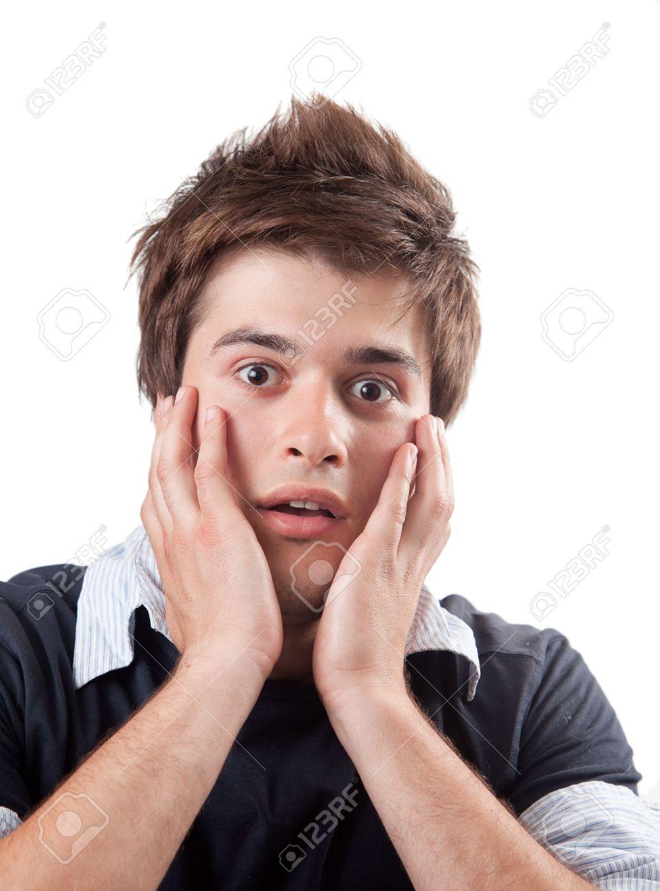 Amazed scared young man isolated on white background Stock Photo - 10059760