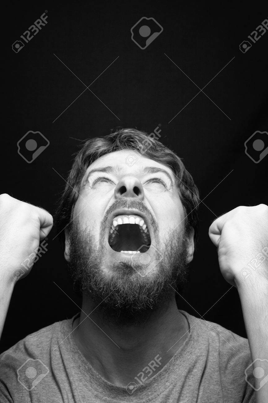 Scream of angry rebel man over black Stock Photo - 11130974