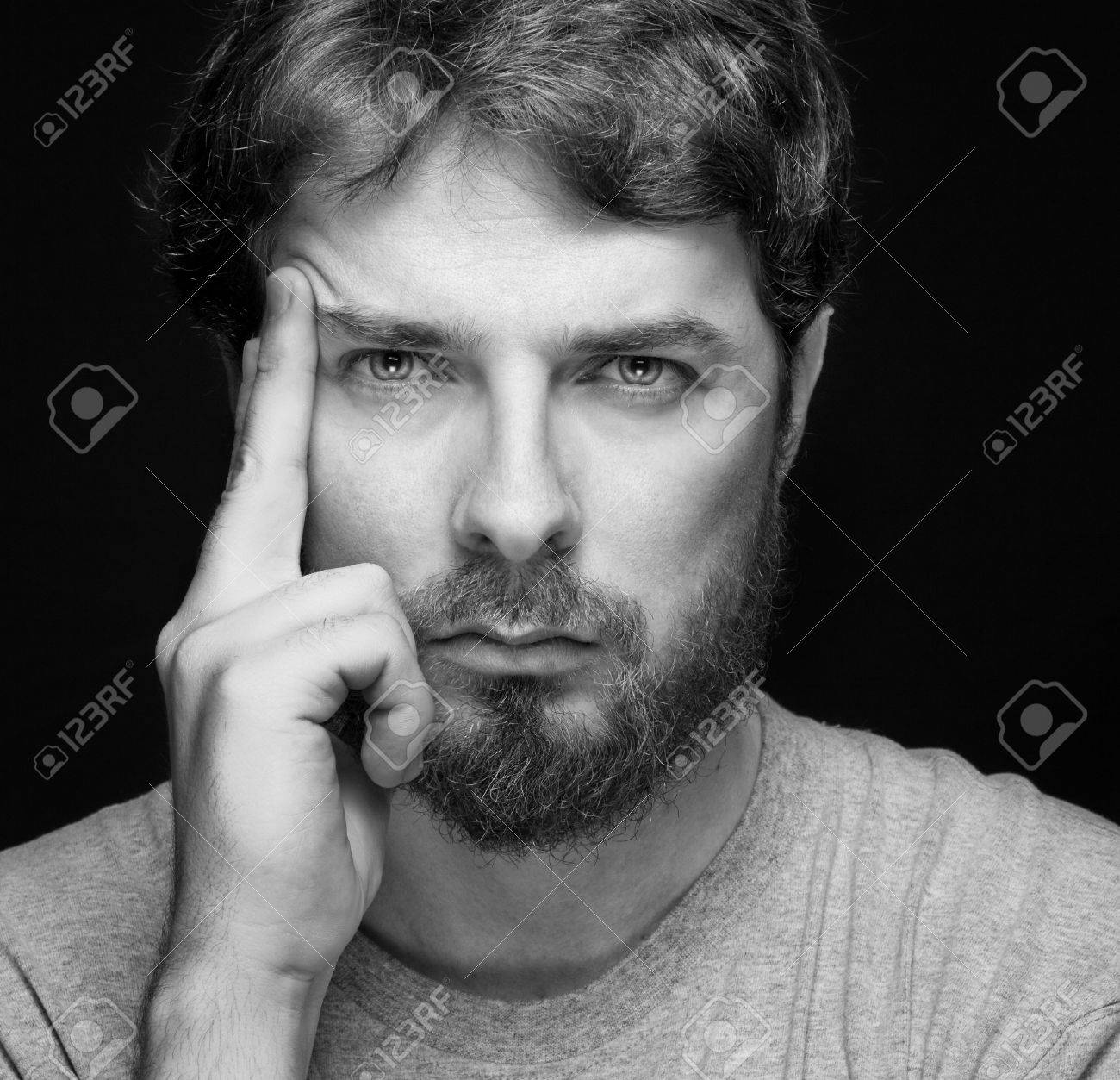 Face of handsome bearded confident young guy over black Stock Photo - 11130967