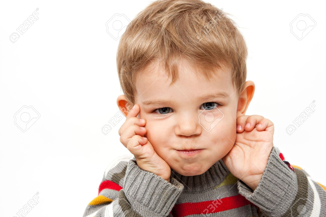 cute kid isolated on white making a funny face stock photo, picture