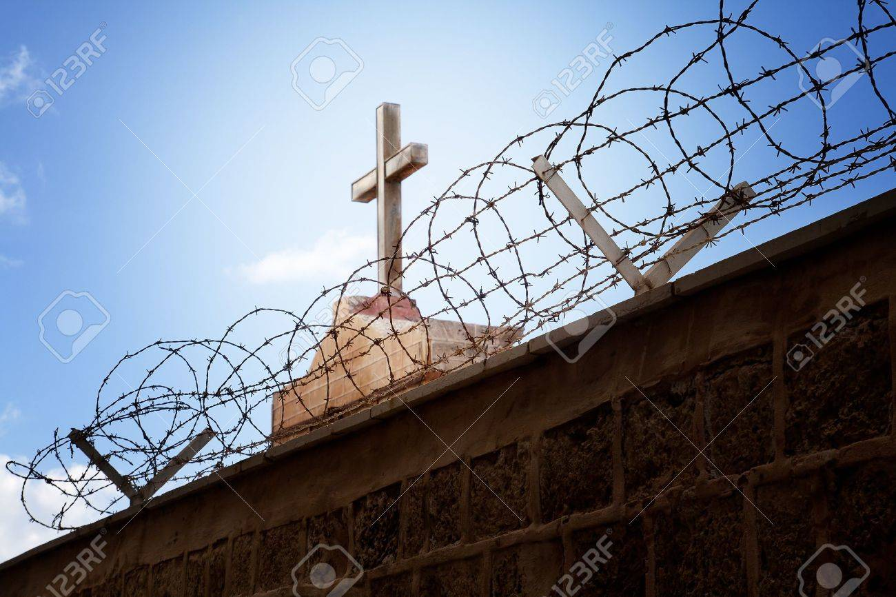 War and religion concept - Cross and barbed wire over blue sky Stock Photo - 11130977
