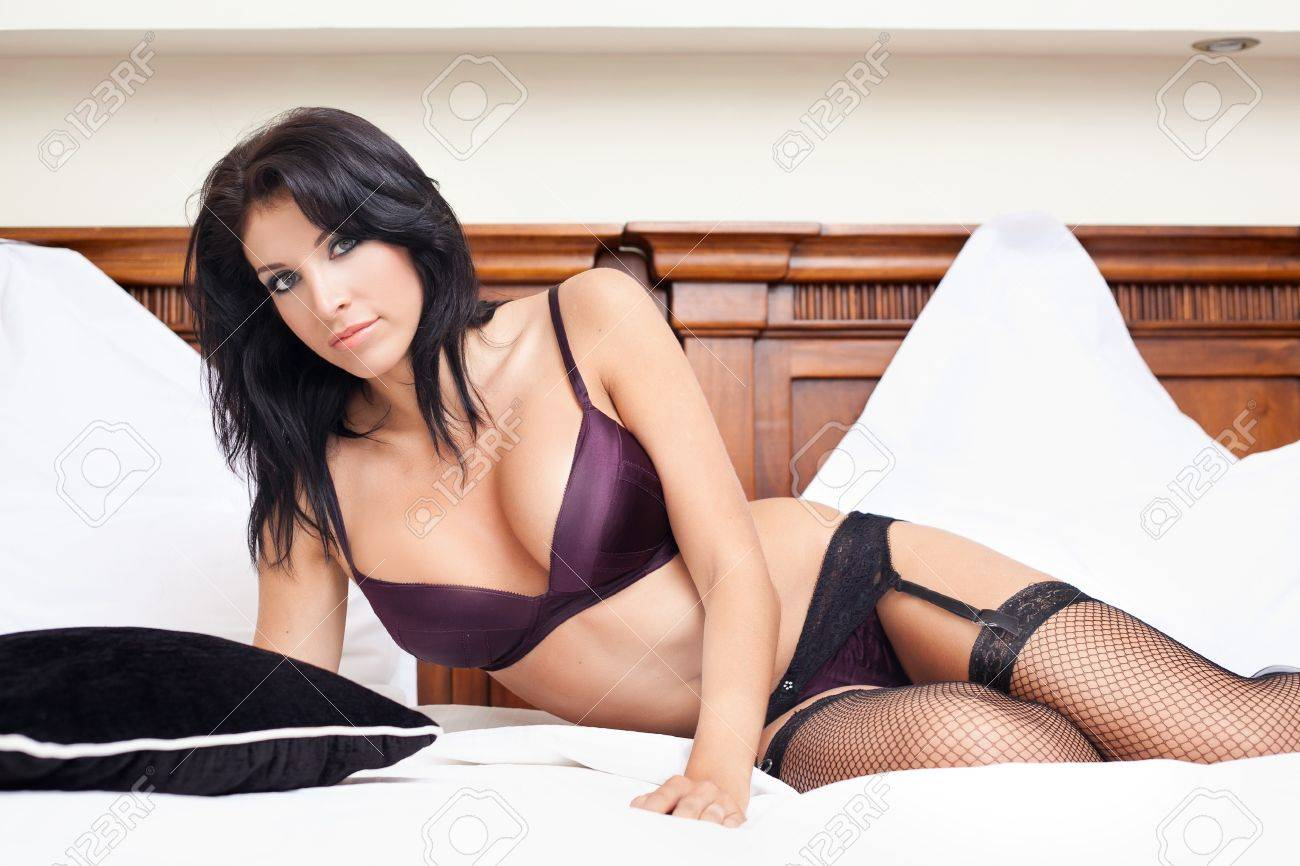 Beautiful woman in sexy lingerie posing on bed Stock Photo - 11130979