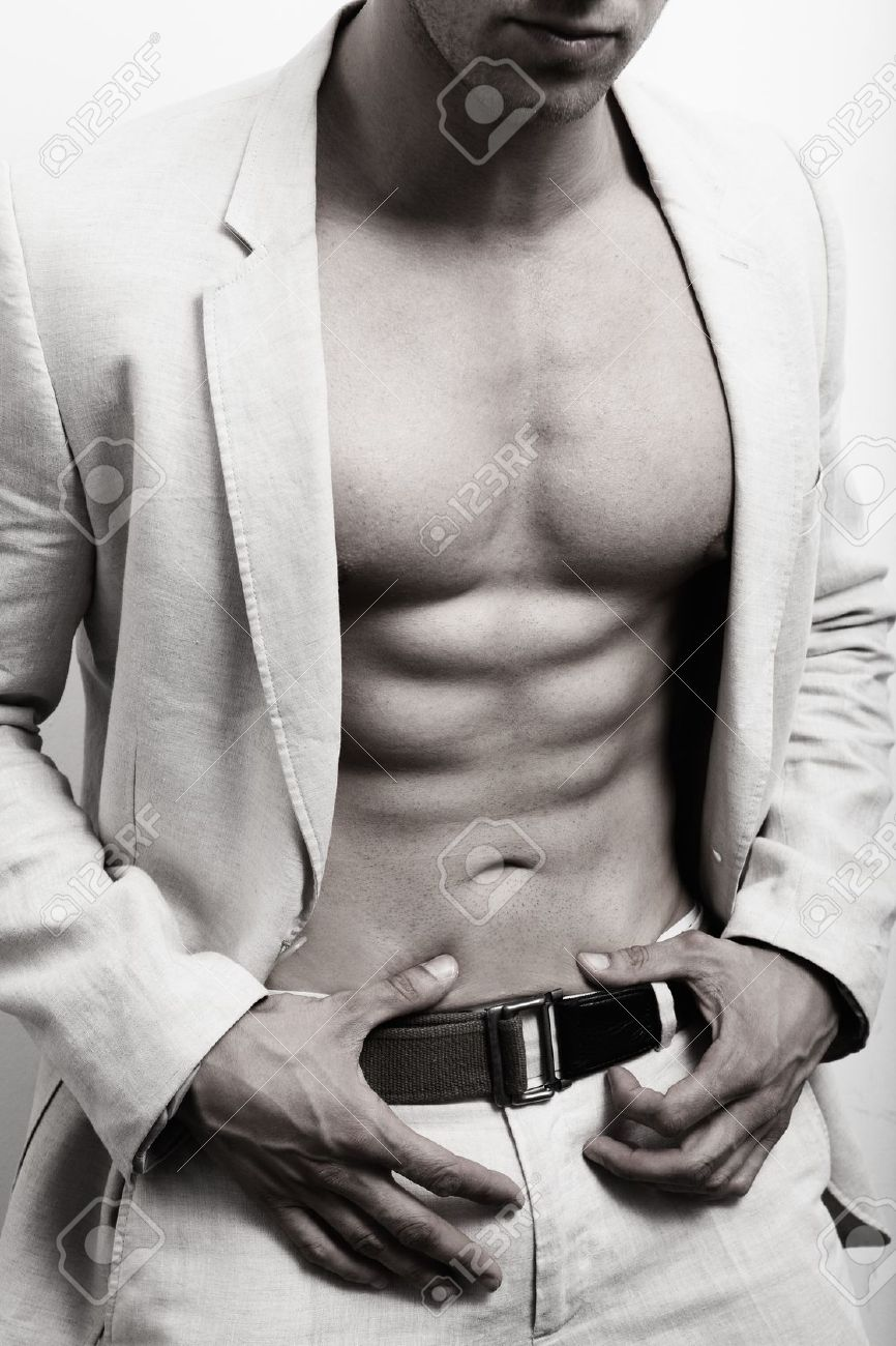Muscular man with sexy abs and suit over white wall Stock Photo - 12552644