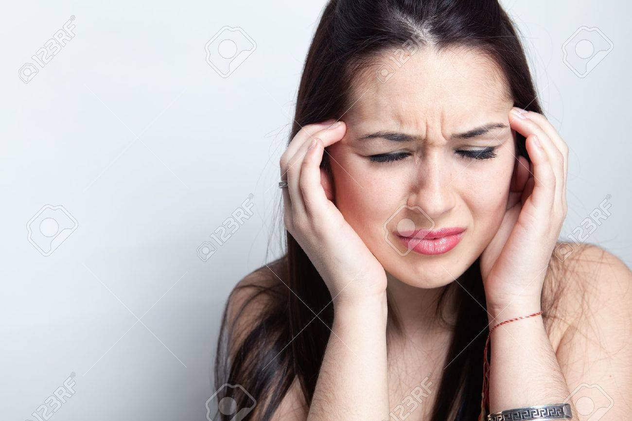 Headache concept - young woman suffering a migraine Stock Photo - 12552666