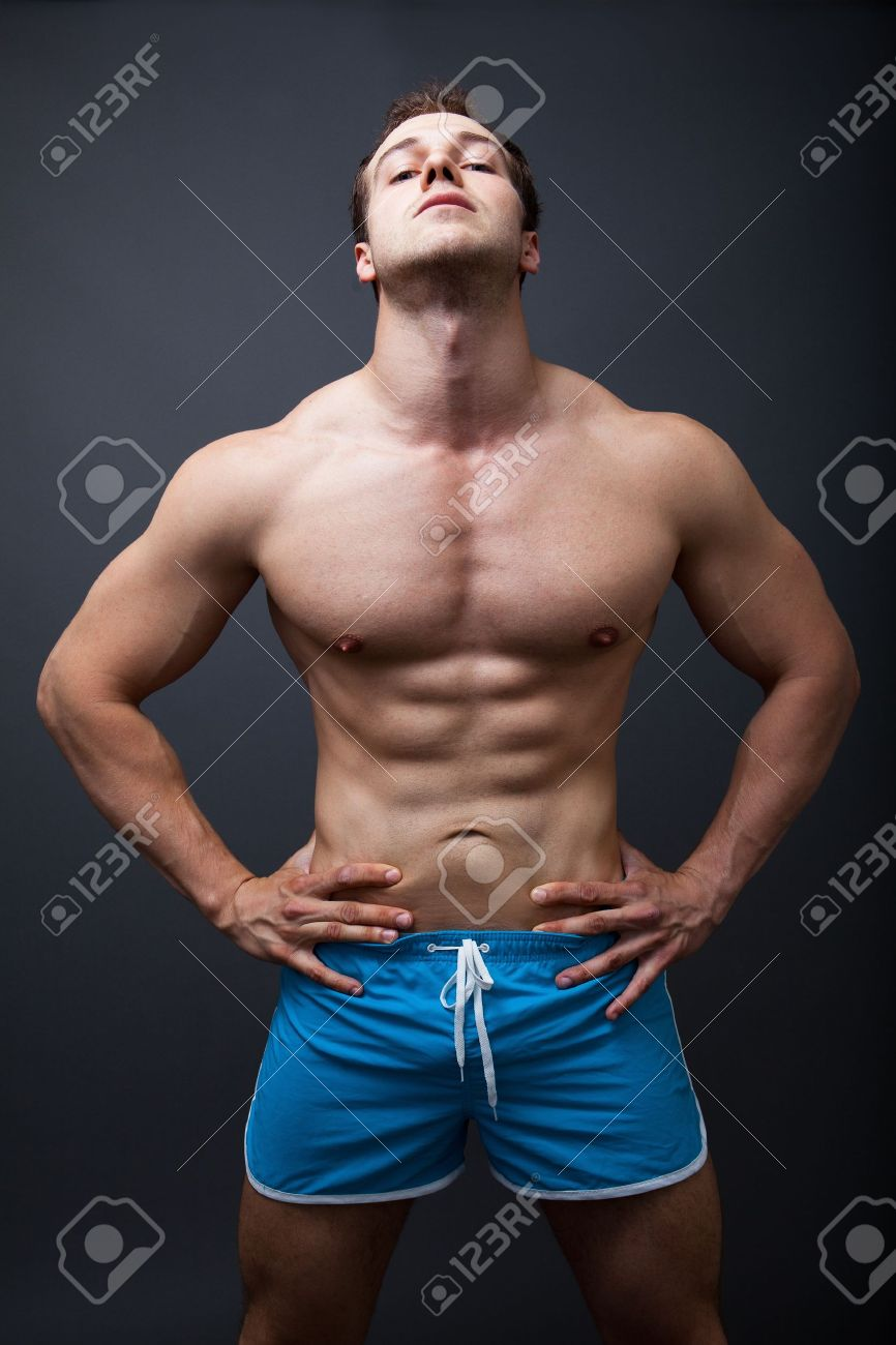 Sexy man with muscular athletic body posing in studio Stock Photo - 12552677